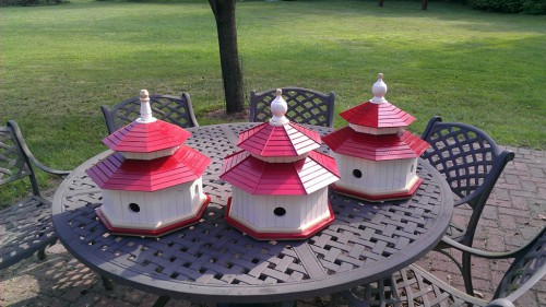 Trio of painted cedar bird houses