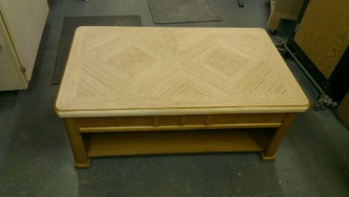 Sheet sander was used to sand off the finish on the entire table.