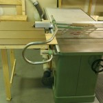 Fold down outfeed table