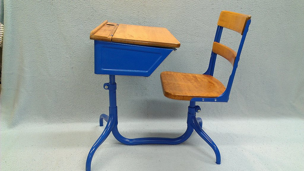 Restored student desk with blue spray paint finish