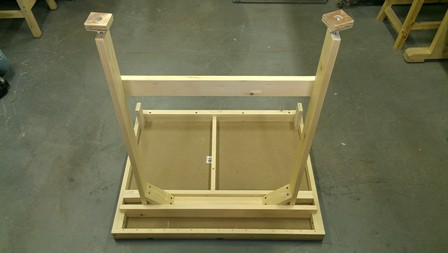 Table legs fit into a slot built into the underside of the table.