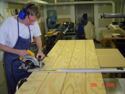Cutting T1-11 panels to size with circular saw