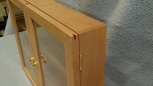 Door frames reinforced with hardwood splines