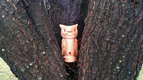 Carved basswood owl guarding the yard