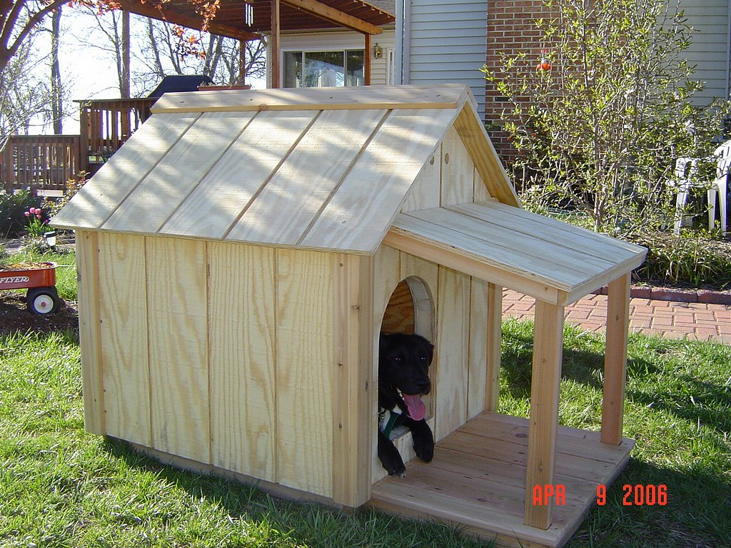 Insulated dog house woodbin for Building on to my house
