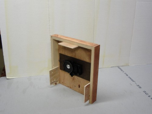 Clock movement mounted to a plywood frame