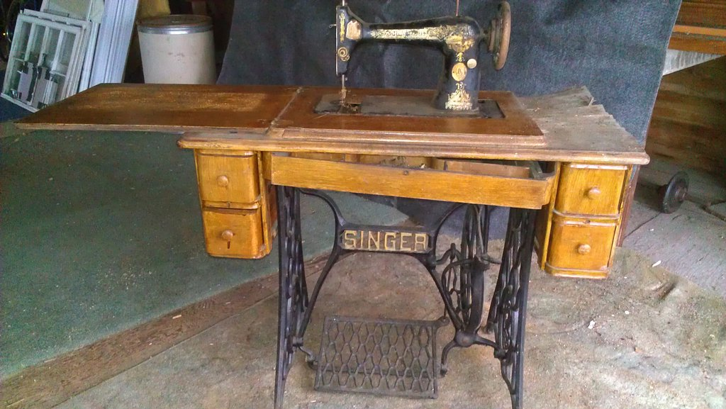 Front View Of Dilapidated Sewing Machine