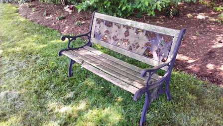 Dilapidated garden bench before restoration