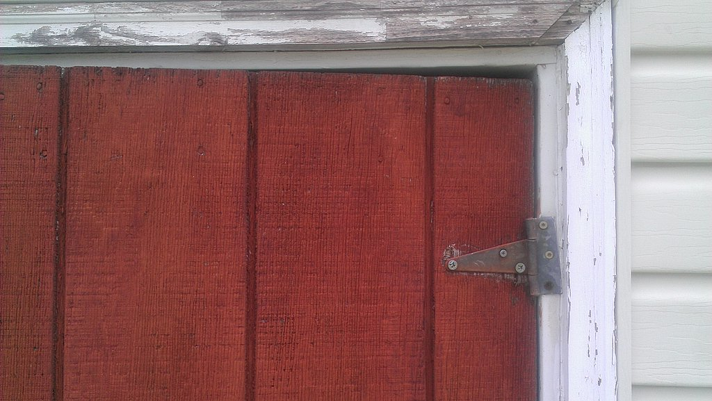 Poorly Installed Hinges On Old Shed Door