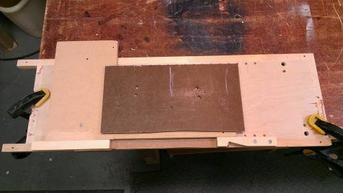 Jig consists of a curved template and adjustable end clamps