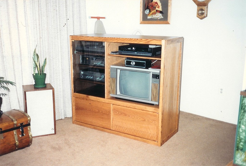 Entertainment center housing a 1980's era TV and stereo system