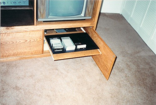 Pull-out tray to store cassette tapes