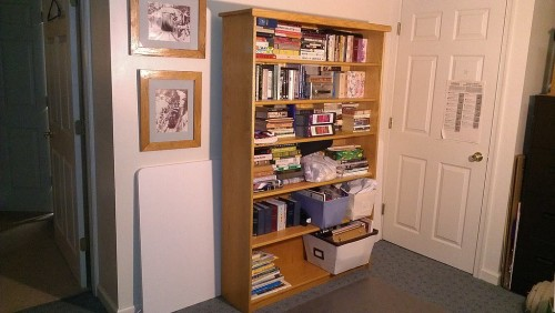 The bookshelf has migrated to the basement office for general purpose storage