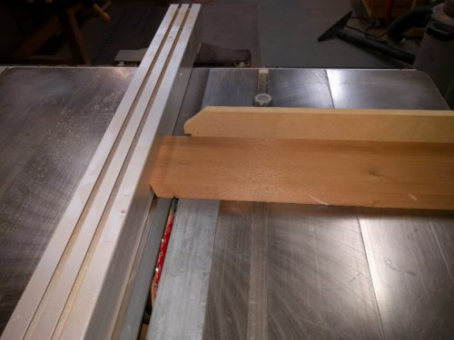 First shoulder kerf is cut using the fence as a stop.