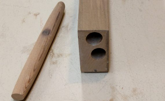 Exposed ends of carpenter bee tunnels