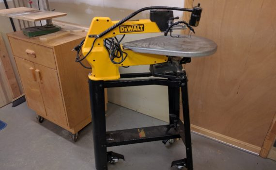 Retractable casters mounted to Dewalt scroll saw stand